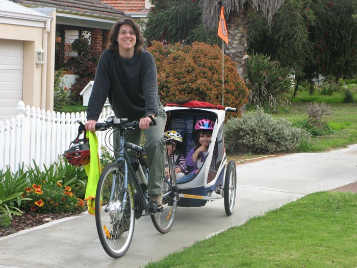 Elizabeth and kids on an electric bike